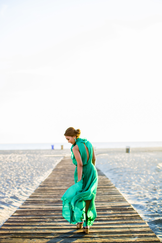 Fashionable Lady in Green Dress on Venice Beach Boardwalk