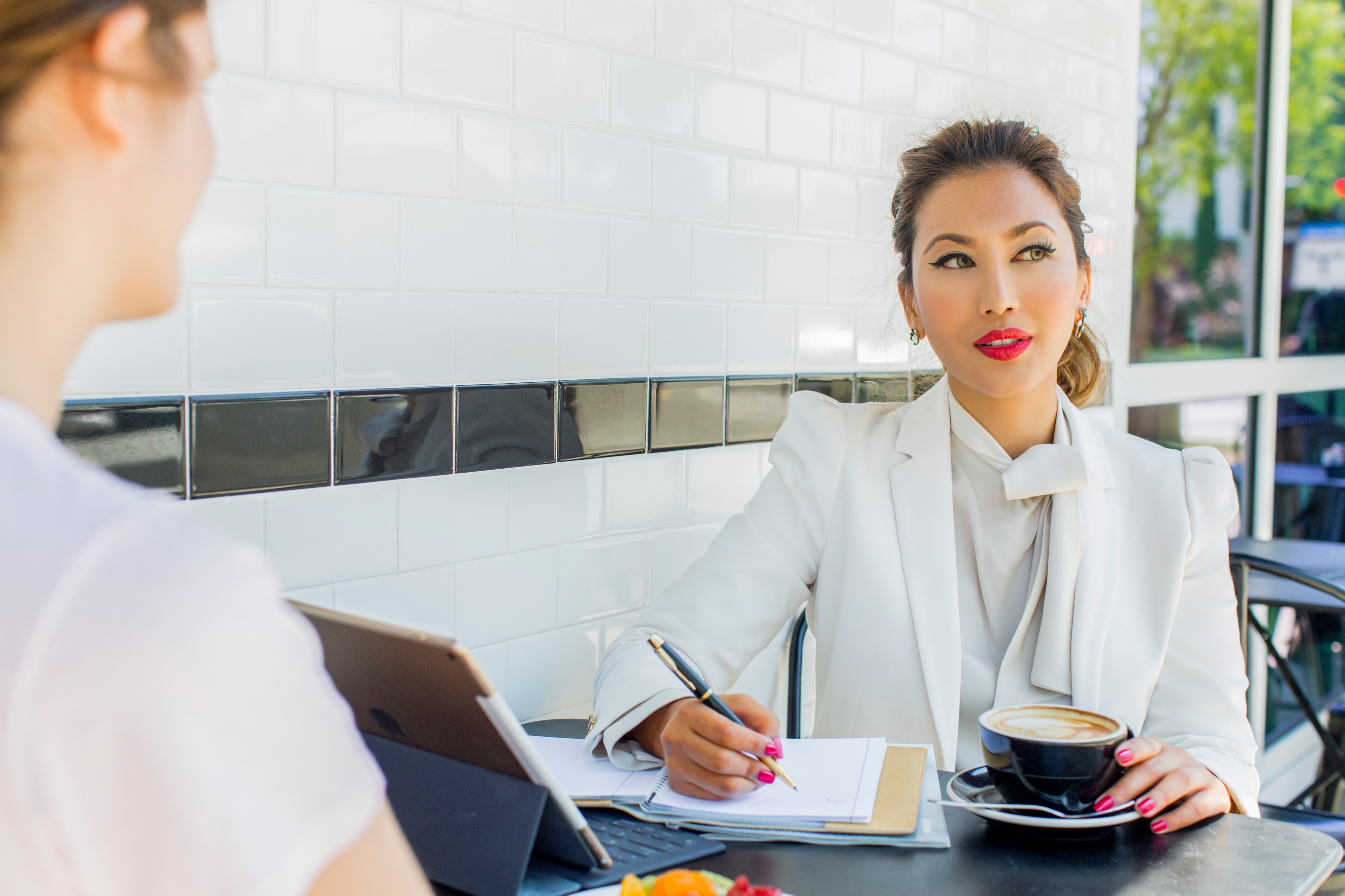 Fashionable Businesswoman in Meeting