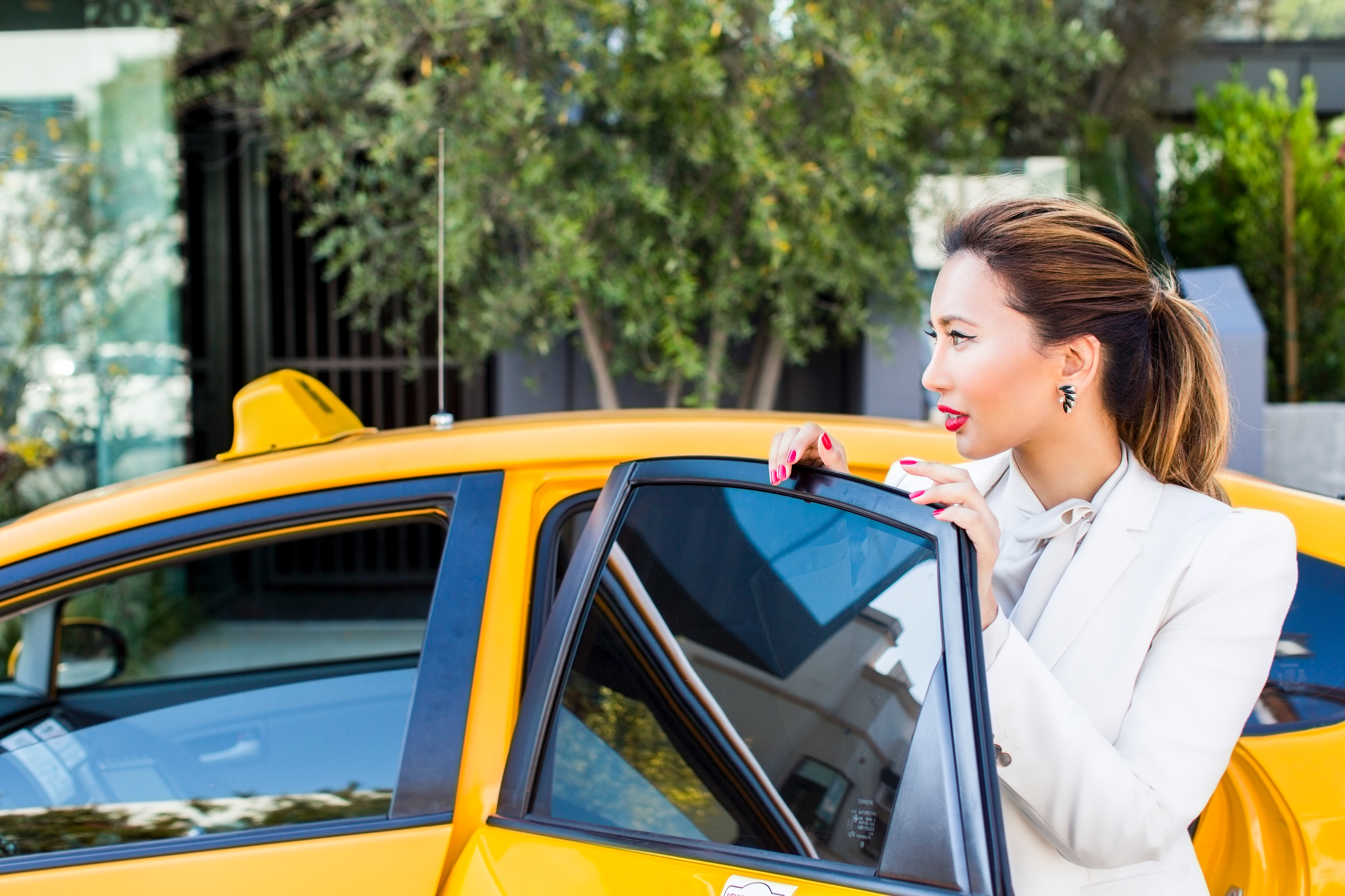 Fashionable Woman Taking Taxi