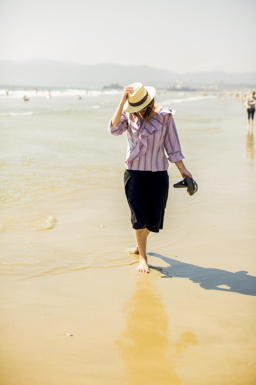 Heidi Nazarudin walks on the beach
